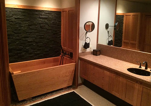 Castle wooden bathtub installed in large bathroom