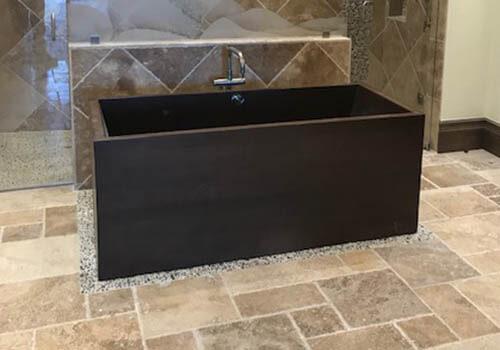 Damon Wooden Bathtub installed in roomy bathroom