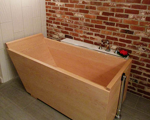 Wooden Bathtub installed in industrial space