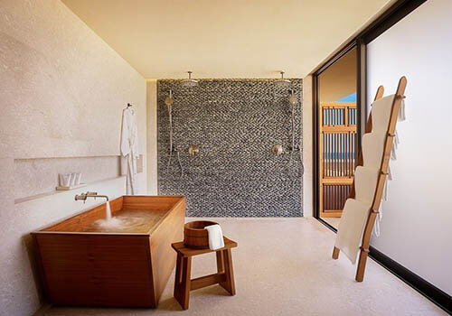 A gorgeous wooden bathtub in a hotel bath