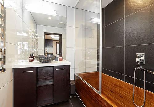A wooden bathtub in a hotel bathroom
