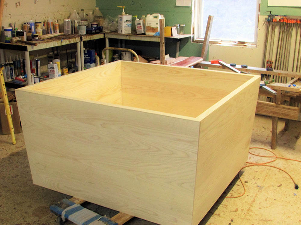 A new wooden bathtub still in the shop