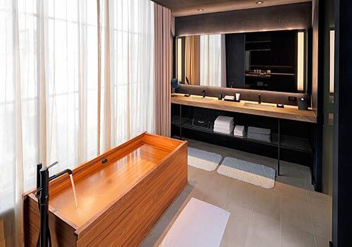A wooden bathtub in bathroom of Nobu hotel in Chicago