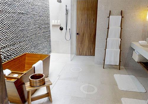 A beautiful wooden bathtub in a hotel bathroom